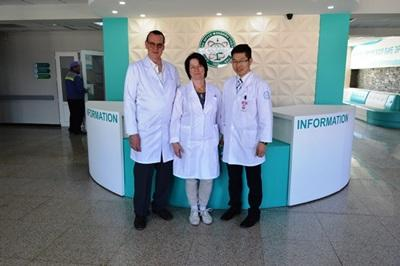 Local and international psychologists pose together at a mental health care centre in Mongolia, Asia.