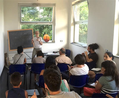 A Projects Abroad volunteer leads a class for refugees and migrants in Italy, Europe