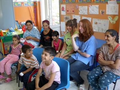 Projects Abroad volunteers get involved in a class with local children and staff at a care centre in Romania, Eastern Europe.