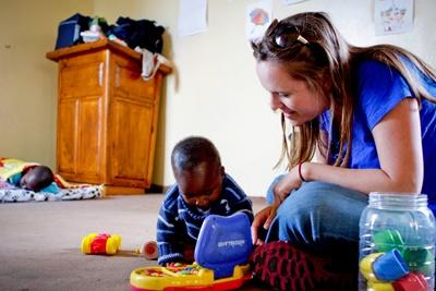 Projects Abroad volunteer plays with a local child at a day care centre in Cape Town, South Africa.