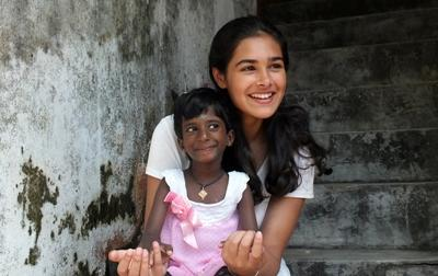 Projects Abroad volunteer spends time with a young girl in Sri Lanka, Asia.