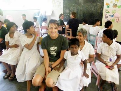 A Projects Abroad volunteer helps to support children with special needs at a care facility in Sri Lanka.