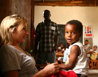 A Projects Abroad volunteer spends time with a child at a care centre in Tanzania.