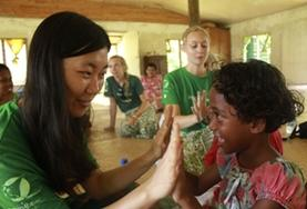 A volunteer plays a game with a child during her Care Project in Fiji.