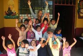A volunteer with children at a day care centre in Peru.