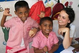 A Care volunteer spends time with children at a kindergarten in Sri Lanka.
