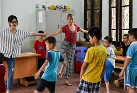 Children learn exercises from volunteers at a special needs centre in Vietnam.