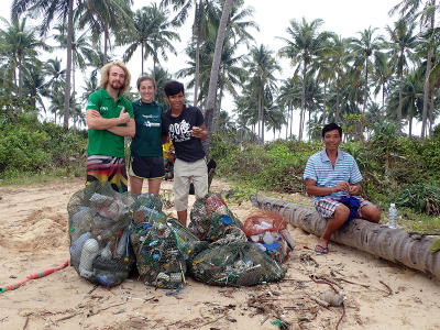 Projects Abroad volunteers and staff at the Conservation Project finish cleaning a beach in Cambodia, Asia.