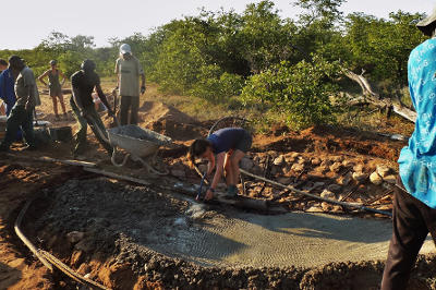 Projects Abroad Bushveld Conservation volunteers help build a waterhole at the Wild at Tuli game reserve in Botswana.