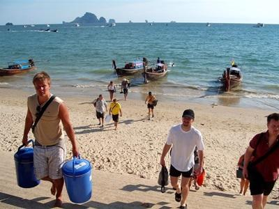 Projects Abroad volunteers carry equipment at the Conservation Project in Thailand, Southeast Asia.