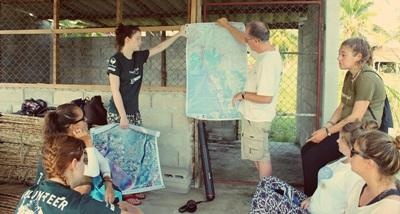 Projects Abroad staff explain an activity to volunteers at the Conservation Project in Thailand.