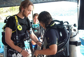 Diving and Marine Conservation volunteers prepare their equipment before a dive in Cambodia.