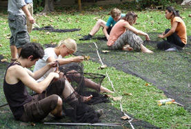 Volunteers on the Rainforest Conservation Project in Peru sew nets as part of their project work.