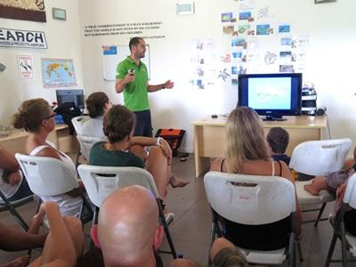 Projects Abroad Conservation volunteers listen to a lecture by scientist Diego Cardenosa in Fiji.