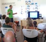 Volunteers listen to a lecture by scientist Diego Cardenosa.