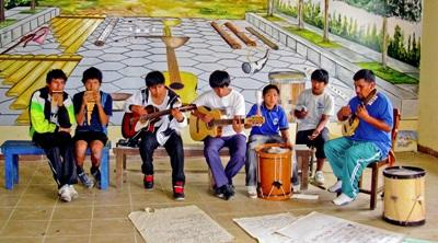 Children in Bolivia form a music band with the guidance of a Projects Abroad volunteer at the Music Project.