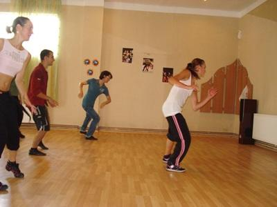 A Projects Abroad volunteer teaches a dance class in Brasov, Romania.