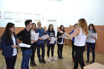 A group of teenagers listen to a volunteer drama teacher in Romania, Eastern Europe.