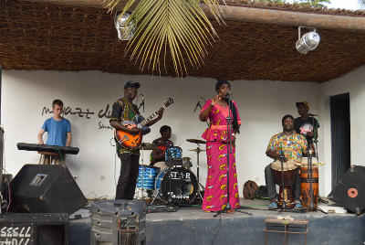 Projects Abroad volunteer plays the keyboard for a Senegalese band in St Louis at the Music & Culture Project.