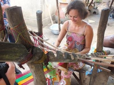 A Projects Abroad volunteers learns how to weave at the Arts & Crafts Project in Togo, West Africa.