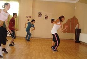 A volunteer leads a dance lesson in Romania on the Creative and Performing Arts Project.