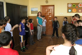 A stage production with a volunteer and local student on the Drama Project in Romania.