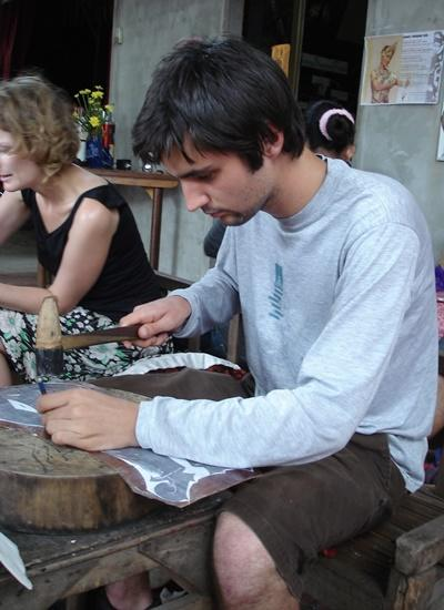 A volunteers learns local Khmer arts and crafts at his project with Projects Abroad in Cambodia.