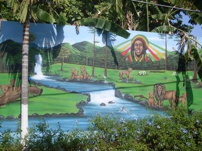 A mural painted on a wall in a local community in Jamaica.