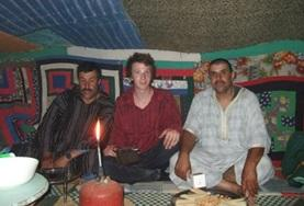 Volunteer with his nomad host family in Morocco.