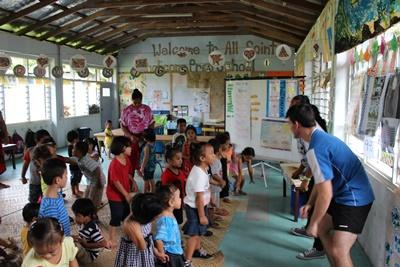 Projects Abroad volunteers in Samoa play a game with young children at a kindergarten.