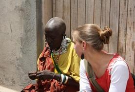 Volunteer on the Culture & Community project in Tanzania chatting with a Maasai community member