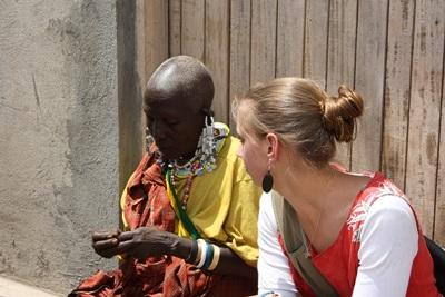 A Projects Abroad volunteers speaks to a local woman in a Tanzanian village in East Africa.