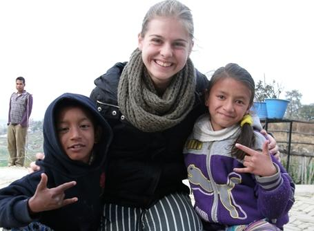 Two children take a picture with a Projects Abroad Care volunteer in Nepal, Asia.