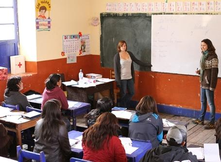 Projects Abroad volunteers teach a class for local English teachers in Peru, South America.