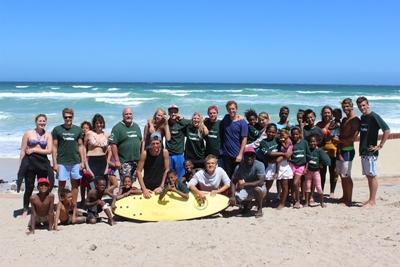 Projects Abroad volunteers and children after a class at the Surfing Project in Cape Town, South Africa.