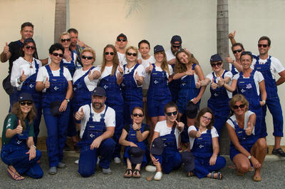The Celgene corporate group from Poland decide to all buy matching dungarees for their building uniform