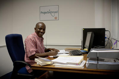 A staff member in his office