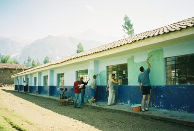 Projects Abroad volunteers give a school a fresh coat of paint as part of their community activities in Ecuador.