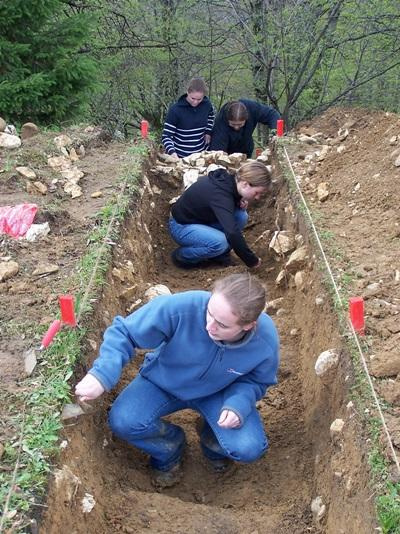 Young volunteers dig for ancient artifacts at an archaeological site in Romania during their High School Special program.