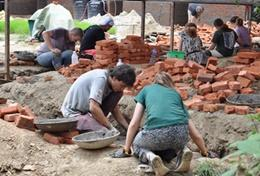 Student volunteers on the Building High School Special Project in Nepal work on the foundations of a school.