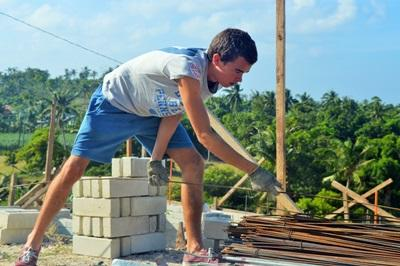 A volunteer on the Projects Abroad Building High School Special works at a construction site in the Philippines.