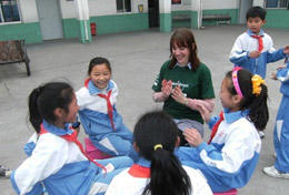 A high school volunteer spends time with children in China during her Care Project.