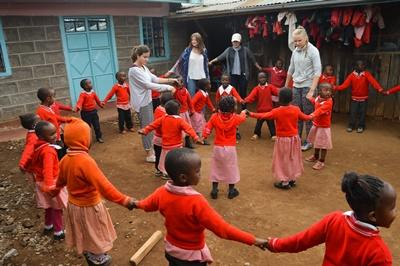 Projects Abroad High School Specials volunteers play outside with kids in Kenya, Africa.