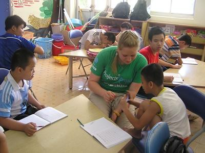 A Projects Abroad Care & Community volunteer helps children with special needs in Hanoi, Vietnam.