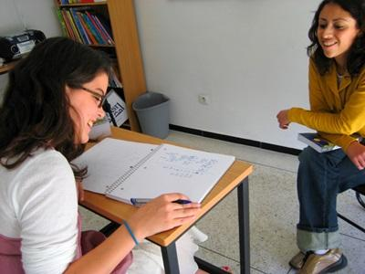 A local teacher has a language class with a volunteer at the High School Special program in Morocco.