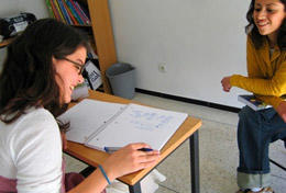 A high school volunteer plays a classroom activity with children in Morocco.