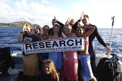 High School Special volunteers take a photo together after completing a survey dive at the Shark Conservation Project in Fiji.