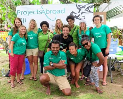 Projects Abroad volunteers and local staff pose for a photograph at the Shark Conservation Project in Fiji, South Pacific.