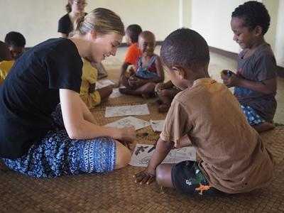 Fijian children participate in an arts and crafts activity with teenage Projects Abroad volunteers
