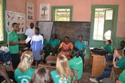 Projects Abroad Human Rights volunteers and staff talk about preventing child trafficking at a school in Ghana, Africa.